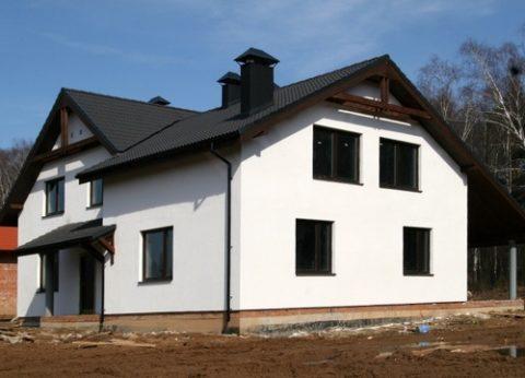 Отделка загородного дома фактурной смесью
