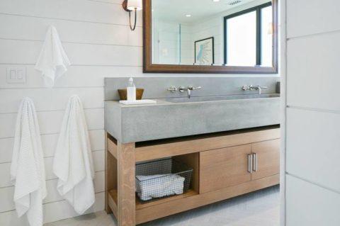 Дизайн интерьера ванной комнаты с раковиной из бетона