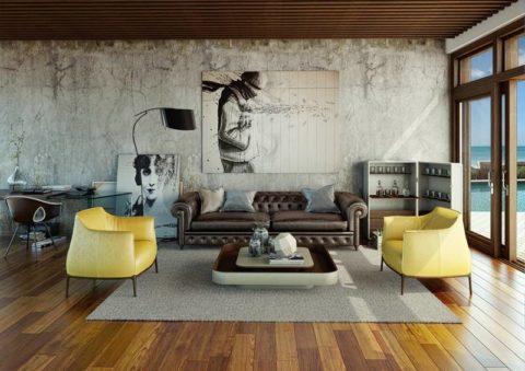 На фоне бетонной стены особенно выразительно смотрится мебель необычного исполнения и картины