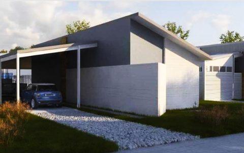 Проект дома с гаражом из пенобетона и навесом для авто