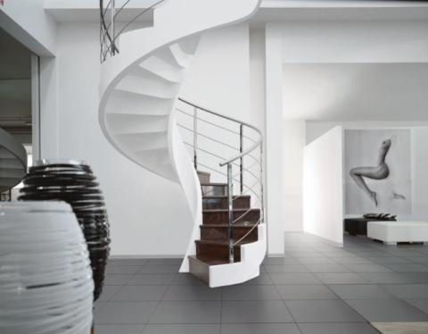 Бетон позволяет создавать лестницы интересных и практичных форм