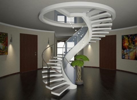 Интересный центральный элемент интерьера – бетонная лестница